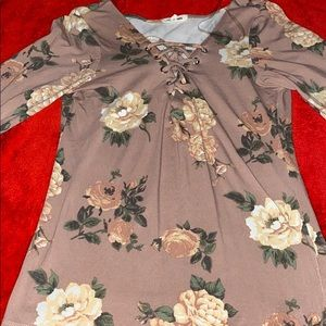 A long sleeve light pink shirt with flowers